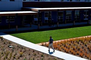 An employee walks through the outdoor workspace in the new headquarters of VF Outdoor.