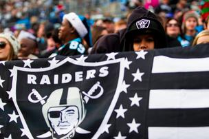 A subdued Oakland Raiders fan flies the colors during a Dec. 23, 2012, game vs. the Carolina Panthers in Charlotte.