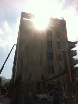 The morning sun peeks through the Helios Building in Berkeley.