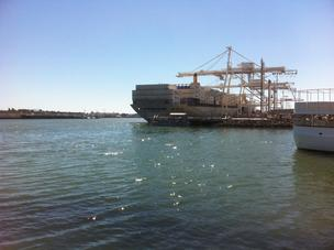 Cranes unloading a ship in the Port of Oakland.