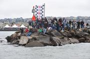 Crowds lined the spit separating San Francisco Marina from the bay to watch racing practice on Aug. 21.