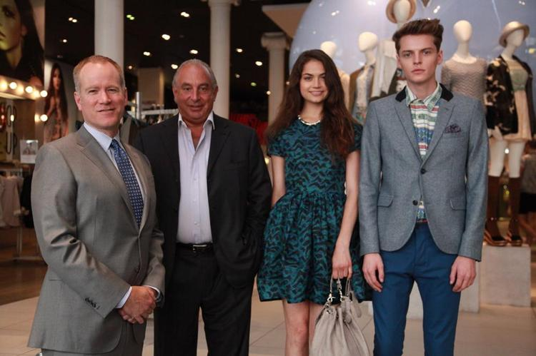 Pete Nordstrom and Topshop's Sir Philip Green stand with models showing some of the looks Topshop carried last fall when it opened in San Francisco's Nordstrom.