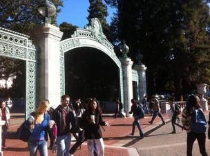 Students walking through Cal's Sather Gate.