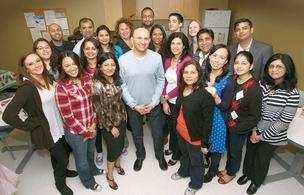 CEO Amar Panchal (center) with the crew at Akraya's Sunnyvale headquarters.