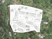 The site plan is superimposed on a satellite image.