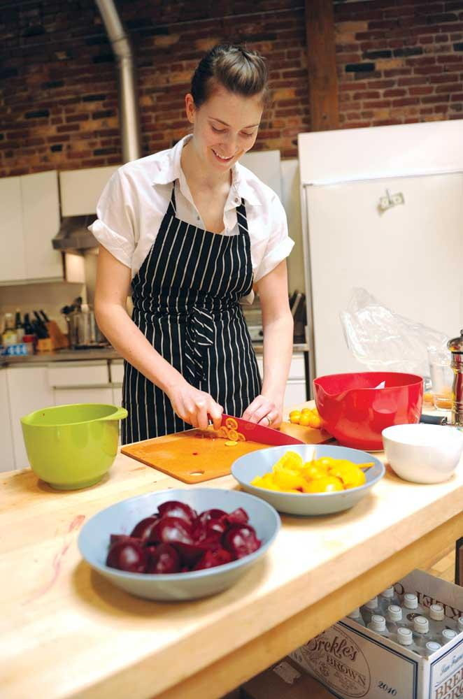 Thea Baumann prepares food for Thumbtack employees and guests.