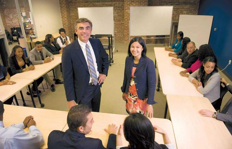 JP Morgan's Georgette Bhathena, right, works with Jay Banfield of Year Up.