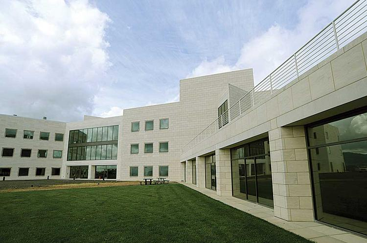 Buck Institute's new stem cell facility, left, connects with its original building.