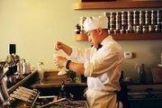 Alan Chen, a soda jerk at Ice Cream Bar, mixes it up behind the counter.