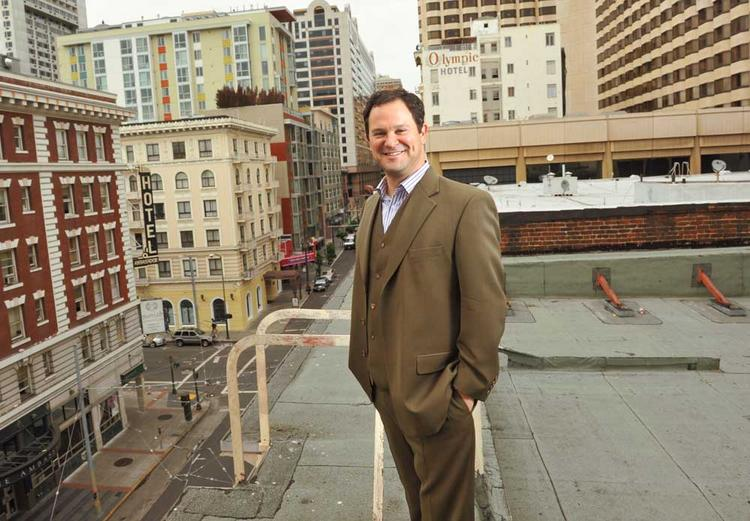 Alex Clemens toasts his new Mid-Market headquarters, with accompanying beer hall.