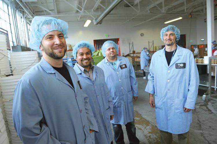 Think local: (Left to right) ICA's Sean Murphy and Jose Corona work with Premier Organic manager Mauricio Duque and CEO Santiago Cuenca-Romero.