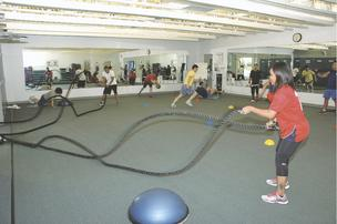 Angelyn Carino-Williams, LiveWell program manager at Texas Instruments, battles ropes to push her fitness.