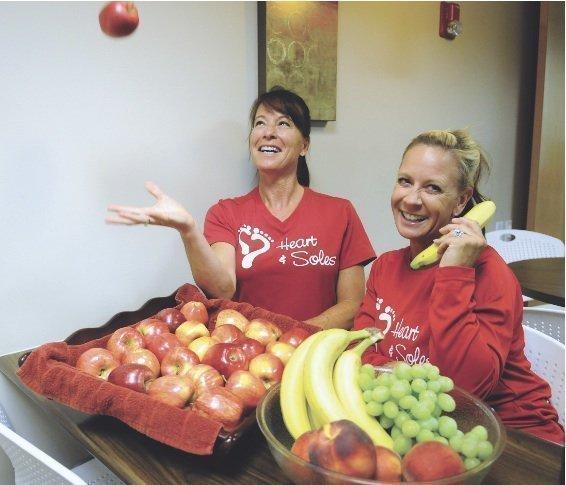Fruit calls: Monique Renard (left), wellness program coordinator, samples healthy snacks with Lori Winsor.
