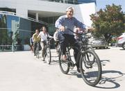 DES Architects + Engineers Inc.No. 1 in the midsize companies (100-499 employees)Click here for full storySteve Mincey, CEO of DES Architects, leads employees on a spin. The  company offers bikes for employees to ride around Redwood City while at  work.