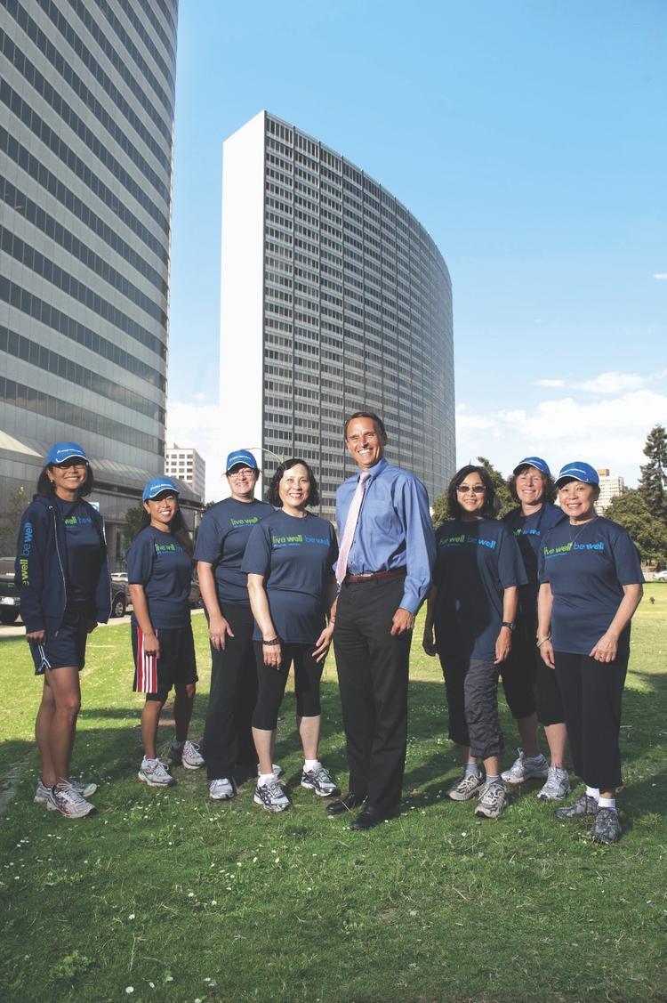 Robert Pearl finishes his jog with co-workers without breaking a sweat. Even former couch potatoes rave about Kaiser's exercise culture.