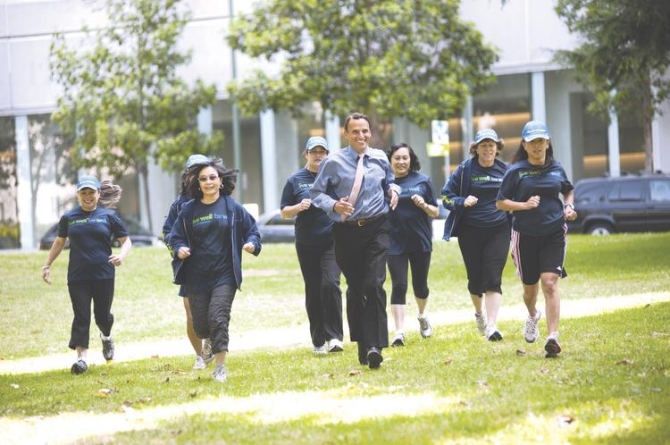 Robert Pearl leads the pack in a friendly staff jog, and leads Kaiser Permanente Medical Group, the Bay Area's healthiest large employer.