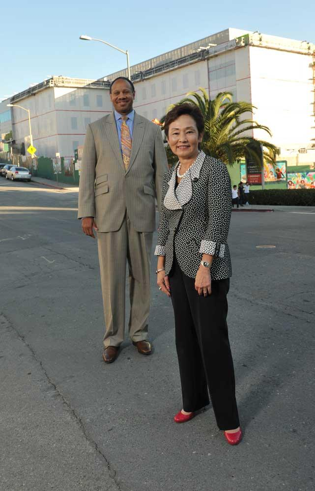 """""""It's down to finishes now,"""" says CEO Wright Lassiter III, left, of Phase I of the Highland Hospital rebuild, with Alameda County Administrator Susan Muranishi, who oversees the $668 million seismic rebuild and expansion project."""