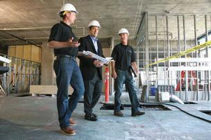 Rick Millitello, president of Skyline Construction (center) tours a construction site, one of a growing number in the Bay Area, with Mike Wertz (left) and Jeff Duncan.