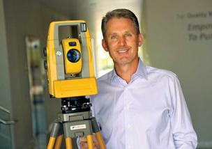Topcon's Ray O'Connor, with robotic surveyor, wants to automate construction, ag.