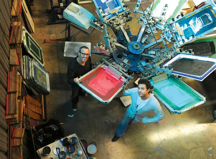 """""""It's not for everyone,"""" says Levine (right, with co-founder Scult) of Golden Goods' tailored designs and organic inks."""