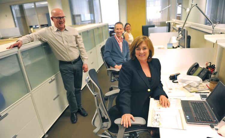 Margi Sullivan (front) of Sidemark Corporate Furniture shows off tech space with Gary Nichols (left), Daniel Krivens and Elizabeth van Dyk of NicholsBooth Architects.