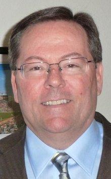 Terence J. McManus, REA