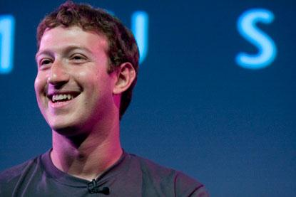 Facebook CEO Mark Zuckerberg said his company has great momentum for  2013. Its revenue and earnings per share both ticked up for the fourth  quarter.