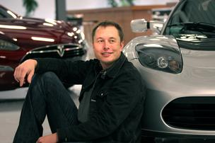 Elon Musk and a Tesla Roadster.