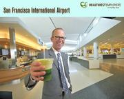 John Martin, San Francisco International Airport's director, is eating more fruits and vegetables, thanks to the airport's wellness program. SFO, which ranked first place in the 500- to 1,999-employee group, spends $750,000 each year on its health program, which includes exercise classes, an on-site medical clinic, and an organic garden.