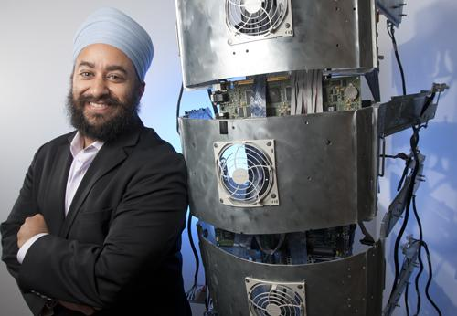 Appirio took old servers no longer needed by companies and turned them into artwork, commissioned by local artist Jamie Banes. Here company Chief Strategy Officer and co-founder Narinder Singh poses with a piece created to look like a backbone.