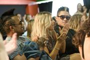 Member of the Black Eyed Peas, from left, apl.de.ap, Fergie and Taboo applaud performers during unveiling of the Peapod Adobe Youth Voices Academy at MACLA in downtown San Jose on Saturday night.