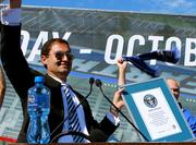 It's official: Earthquakes President Dave Kaval celebrates while holding the Guinness Word Record plaque awarded for the biggest groundbreaking event on record.