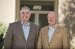 FrontRange Solutions Inc. chief financial officer Bob Corey, left, and chief executive Jon Temple are moving their company to Milpitas from Pleasanton.