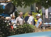 Director Joshua Michael Stern is shown here (center man) at Steve Jobs' former home in Los Altos where he is filming a biopic on the Apple co-founder that stars Ashton Kutcher in the title role.