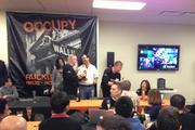 "Ruckus Wireless employees at the Sunnyvale company's headquarters celebrated their IPO on Friday wearing t-shirts that read ""RKUS"" and ""Occupy Wall St.: Ruckus Style"""