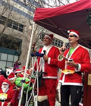 San Jose City Council Member Sam Liccardo, left, and Silicon Valley Leadership Group CEO Carl Guardino emceed the start of the Santa Run on Sunday.