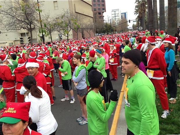 The first Santa Run in San Jose attracted 2,700 participants, many of them dressed as the jolly old elf, to raise $90,000 for Christmas in the Park and Holiday Ice, downtown's annual yule attractions.