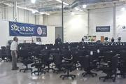 Potential bidders look over a room full of office chairs that are being auctioned off as part of the bankruptcy of solar panel maker Solyndra this week.