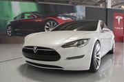 The first Tesla S sedans, all made at the former GM-Toyota plant in Fremont, were delivered Friday in a celebratory event.
