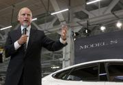 """California Gov. Jerry Brown called the Tesla Model S an example of the """"boldness"""" of the state, attending the ceremony marking the delivery of the first electric sedans made at the company's Fremont factory."""