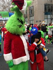 It was either County Assessor Larry Stone dressed as The Grinch or The Grinch dressed as Larry Stone at the Santa Run in San Jose on Sunday.