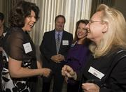 Patty Nation, manager of corporate and community engagement at Xilinx, chats with Business Journal Editor Moryt Milo at the Women of Influence event Thursday night.
