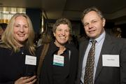 Among those enjoying the Women of Influence event were, from left, Tamara Whiteside of Apple, honoree Katy Basile of Novak Druce & Quigg, and Vince Dorn.