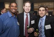 From left, Greg Hughes from Comcast Business Class with Ryan Bates and Ron Hecht from the San Francisco 49ers at the Silicon Valley Business Journal's Structures Awards.