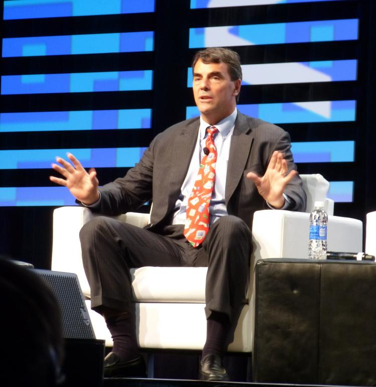 Venture capitalist Tim Draper gave a talk - and sang a song- at the Global Mobile Internet Conference in San Jose Friday.