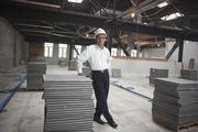 Thang Do, principal planner for Aedis Architects, at the building he purchased in San Jose's SoFA district to house the company and a new food and retail marketplace.