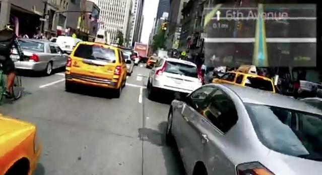 Google has posted a YouTube video that shows what the world looks like through its augmented reality glasses. This is how you GPS navigation looks like while driving on a city street. The video is embedded below the advertising here or you can go here to watch it on YouTube.