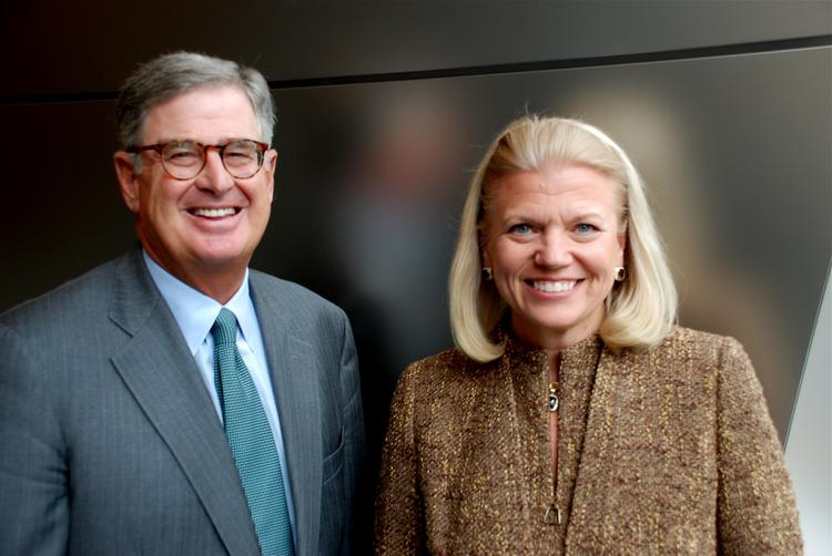 IBM on Tuesday named Virginia Rometty, right, as its next CEO to succeed Sam Palmisano, left, who will remain as chairman.