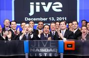Jive Software CEO Tony Zingale, center behind podium, and other executives celebrated the company's strong debut on the Nasdaq on Tuesday.