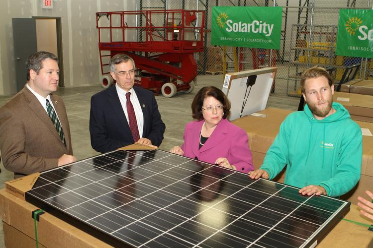 From left, New Jersey Assemblyman Daniel Benson, Representative Rush Holt, Senator Linda Greenstein and SolarCity staff discuss the company's New Jersey expansion at its new Cranbury, New Jersey-based facility.